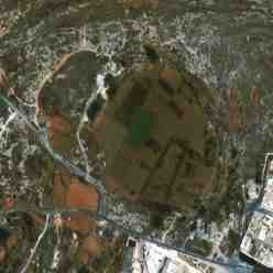 Bahrija crater Malta - satellite view of the crater and the secondary rim shot hit crater