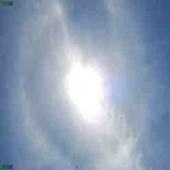 Sun Halo photographs - is this effect just optical or do Electric Clouds create a different Electric discharge?